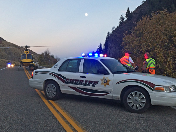 Deputies block the road to Blacksmith Fork Canyon as firejumpers prep their helicopter. (Erin West photo)