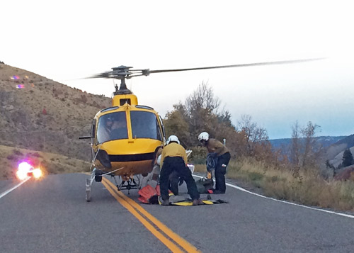 Firefighters prepare their gear to fly into Blacksmith Fork Canyon to fight Friday's fire. (Erin West photo)