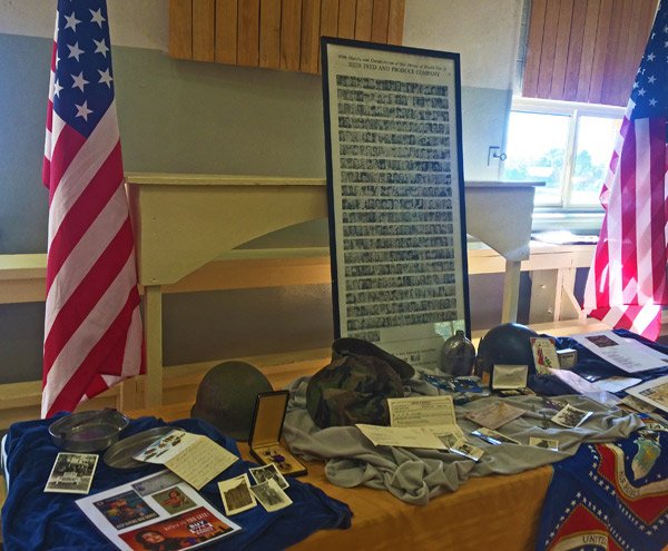 SMITHFIELD's SERVICE — Displays honoring the town's veterans included canteens and mess kits, medals, photos and other war memorabilia. (Rebecca Wheatley photo)