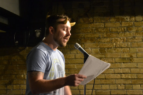 Justin Peterson, sporting horns for Spookfest, performs an original poem.
