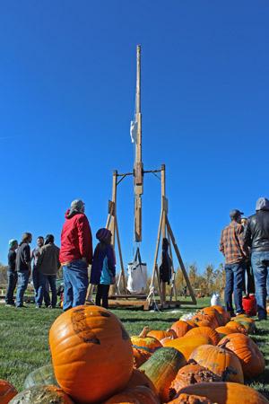 READY, AIM . . . A trebuchet team readies its apparatus to fire off a pumpkin. (Jaesea Gatherum photo)