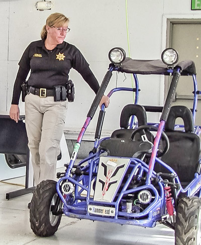 Sheriff's Sgt. Anderson inspects a confiscated dune bugger before the auction. (Amanda Wray photo)