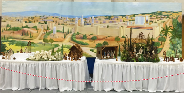 JERUSALEM COMES TO TOWN — Edna Berg's mural of ancient Jerusalem was the backdrop for last week's Nativities of the World exhibit. (Rebecca Wheatley photo)