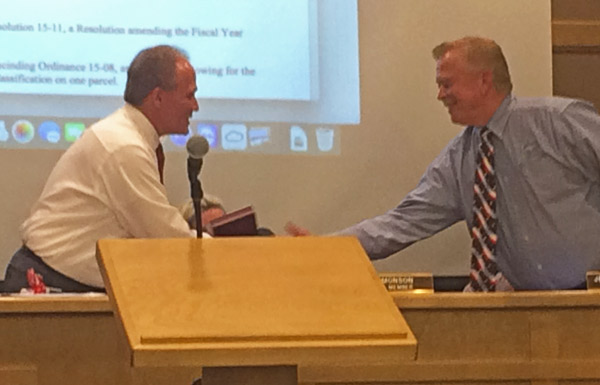 Mayor Simmons thanks Brent Buttars for his 12 years of service to the City Council. (Rebecca Wheatley photo)