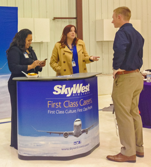 SkyWest recruiters talk to a prospective pilot trainee at USU's first-ever aviation fair. (Amanda Wrap photo)
